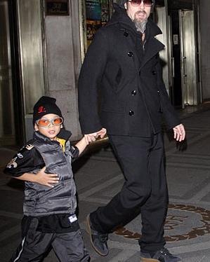 Brad Pitt and Pax Jolie Pitt working an acceptable puffer vest look