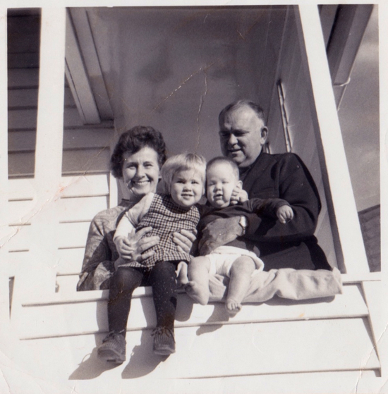 This my Nan and Pop with me and my brother Andrew. It would have been taken at our house in Gympie when I was about two years old
