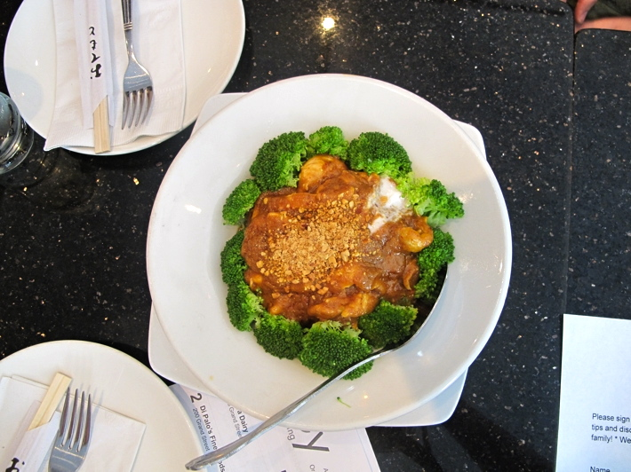 Pra Raam (chicken sauteed in spicy peanut curry sauce, drizzled with coconut cream and served over steamed broccoli) at Pongrsi Thai Restaurant, the oldest family-run and operated Thai restaurant in New York City.