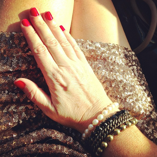Sequin and red nails