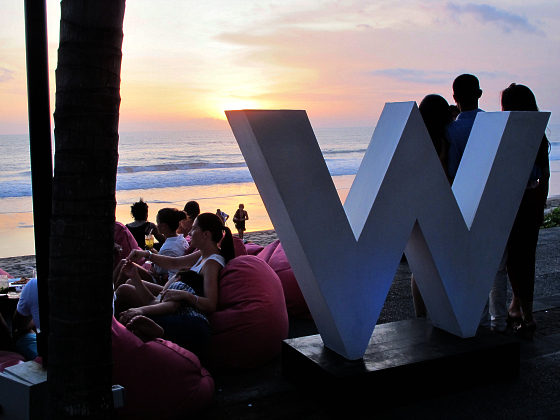 The W Hotel Bali W sign at sunset