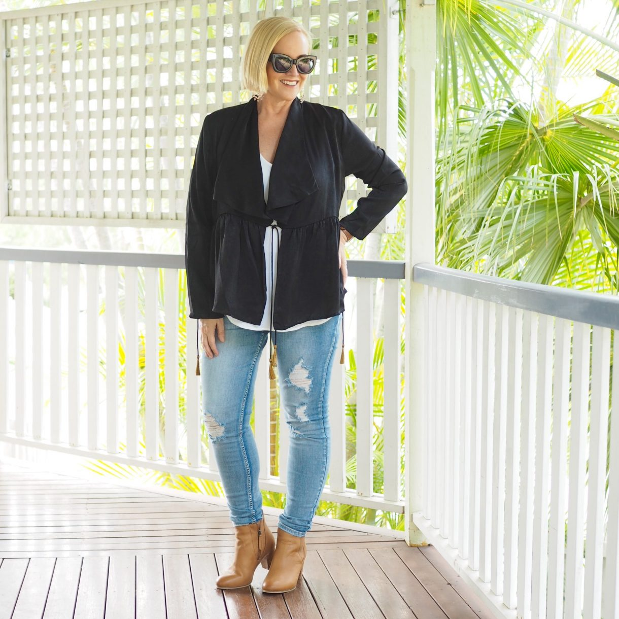 Bohemian Traders waterfall jacket with bronze tassels and distressed denim jeans
